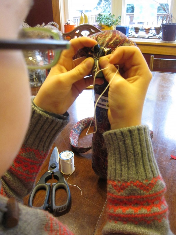Buttons on Upcycled Snake Craft