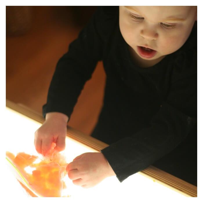 Toddler Exploring Light and Snow