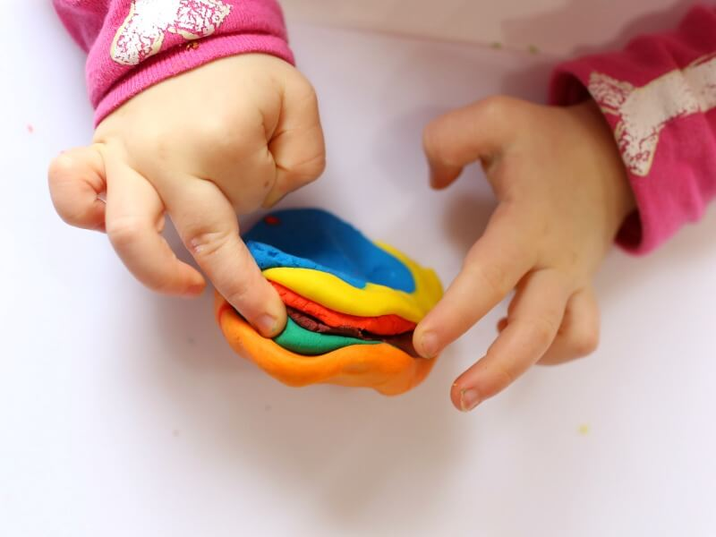 Mixing color play dough with toddlers