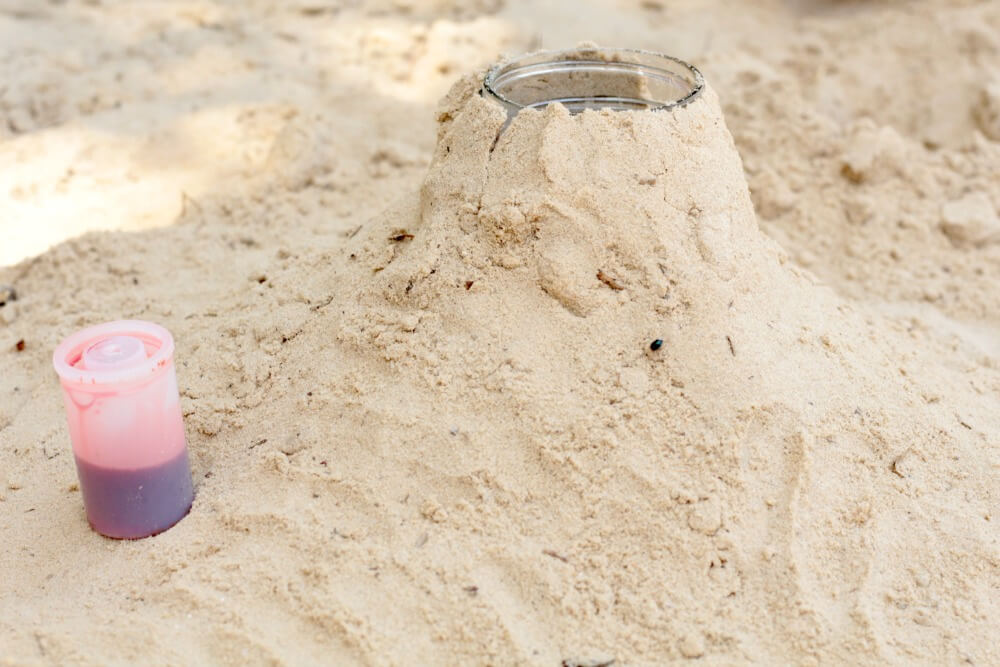 Make a realistic volcano science experiment by adding an explosive element to the traditional science project. This is the perfect outdoor science activity!